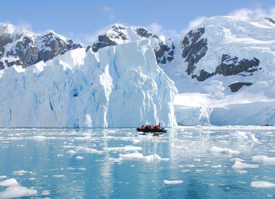 Stock-antarctica-coast-iceberg-boat
